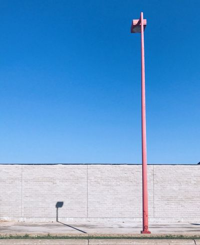 The Street Photographer - 2018 EyeEm Awards The Architect - 2018 EyeEm Awards EyeEm Selects Blue Day Clear Sky Copy Space Architecture No People Built Structure Sky Minimalism Minimal Pink Wall Building Exterior Lamp Post Shadow