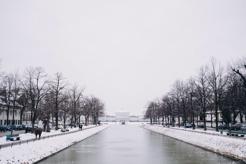 Nymphenburg Palace in winter, Munich, Bavaria, Germany. Architecture Bavaria Copy Space Frozen Horizontal Munich Nature Nymphenburg Palace Tourist Attraction  Travel Photography Tree Winter Canal Cold Temperature Europe Germany Landmark No People Outdoors Schloss Nymphenburg Snow Symmetry Travel Destinations Urban White
