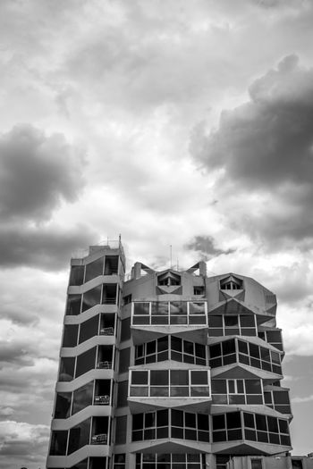 Cloud - Sky Sky Built Structure Architecture Building Exterior Building Low Angle View Nature Day No People Outdoors City Residential District Tower Window Architecture Black And White Blackandwhite Black&white Black & White Clouds Skyporn Overcast Office Building Exterior Travel Destinations Development