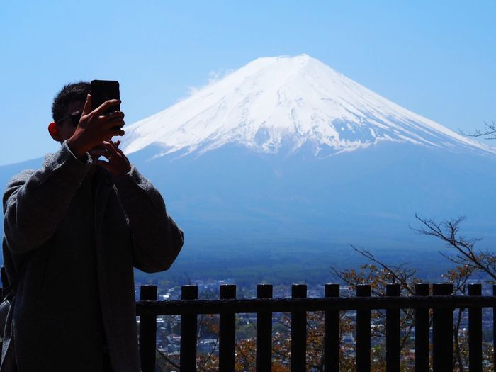 Mt Fuji Japan Fuji Mt Fuji Mountain Winter One Person Snowcapped Mountain Beauty In Nature Snow Cold Temperature Sky Scenics - Nature Lifestyles Leisure Activity Real People Nature Men Technology Non-urban Scene Mountain Range Standing Outdoors Wireless Technology