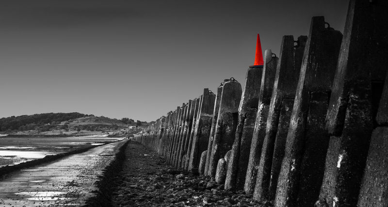 Anyone who goes down to Cramond is probably legally obliged to take this picture. Someone had put a cone on one of the pylons, which made me chuckle. I wouldn't normally use colour popping, but I thought I'd make an exception in this case. Anti-submarine Gun Black And White Causeway Color Popping Colour Popping Cramond Dalmeny Defences Edinburgh Firth Of Forth Forth Estuary Fortheloveofblackandwhite Historic Scotland Island Lothians Mono Monochrome Scotland Scottish Landscape Scottish Landscapes Tidal Traffic Cone War Wartime