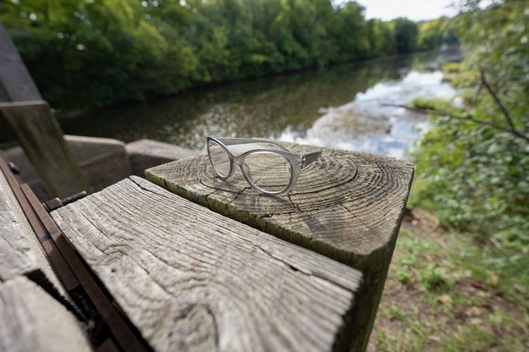 High angle view of bench in lake
