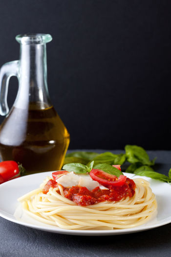Menu Basil Black Background Bowl Close-up Food Food And Drink Food Styling Freshness Gourmet Healthy Eating Indoors  Italian Italian Food No People Olive Oil Pasta Plate Raw Food Ready-to-eat Recipe Savory Food Spaghetti Table Tomato