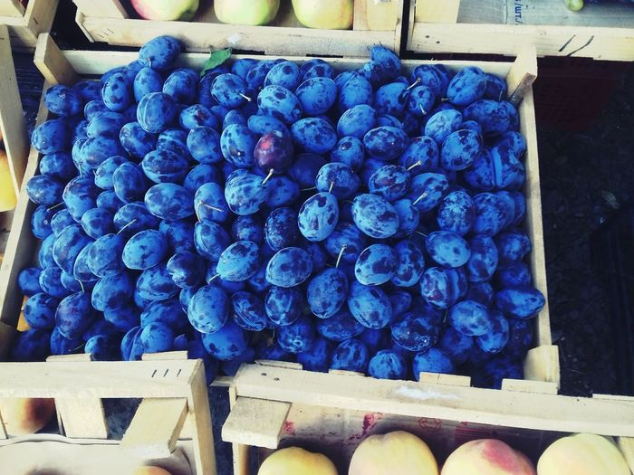 Close-up of grapes in crate at market stall