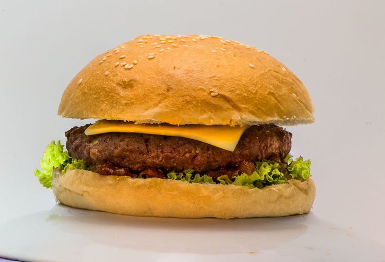 Beef Bun Burger Cheese Close-up Fast Food Food Food And Drink French Fries Freshness Hamburger Indoors  Junk Food No People Ready-to-eat Restuarant Tomato Unhealthy Eating Vegetable Western Food