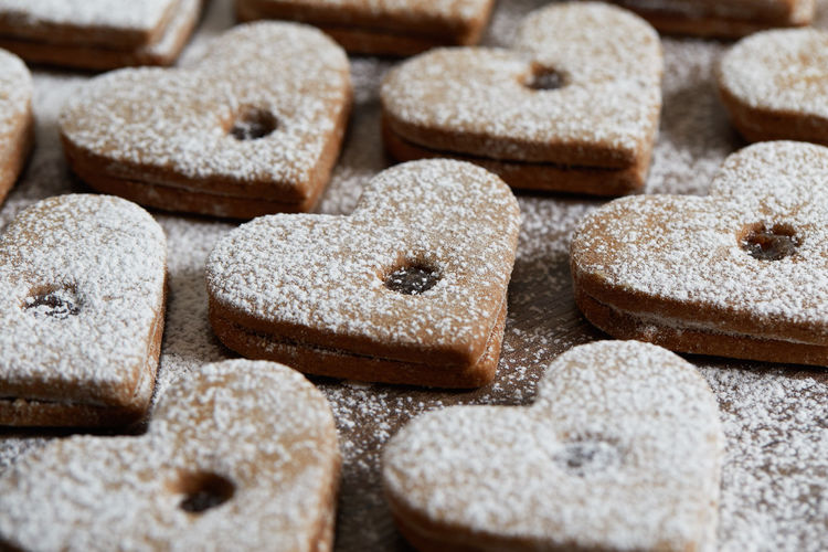 Close up of freshly baked homemade Christmas sugar cookies with jam Food Food And Drink Sweet Food Baked Sugar Powdered Sugar Sweet Indoors  No People Freshness Close-up Dessert Backgrounds Large Group Of Objects Homemade Cookie Selective Focus Full Frame Shape Temptation Homemade Freshness Jam Freshly Baked Freshly Cookies