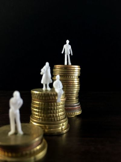 I am the boss. Female Secretary Man Figurine Gender Inequality Discrimination Hierarchy Decision Maker Business Manager Leader Boss Finance Stack Wealth Savings Coin Studio Shot Figurine