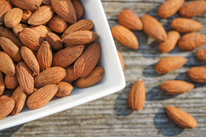 Diet Nuts Almond Almonds Bowl Fat Fiber Fitness Healthy Eating Nut Nutrition Nuts And Seeds Roasted Almonds Snacks Strong Table Wood - Material