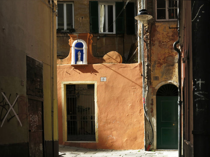 Genoa, Italy, Europe, Liguria Building Exterior Door Window City No People Day Outdoors Sunlight Built Structure Building Architecture Old Entrance Threshold Thresholds Residential District Spirituality Grazing Light