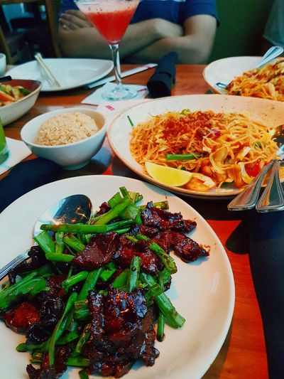 Mongolian Beef & Shanghai Noodles. First we eat and then we do everything else. You don't need a silver spoon to eat your favourite food. Chopsticks are the best! 🥢🍲🧡 #restaurant #friends #Husband And Wife ❤️ #ChineseFood #love #Happiness #followme #newtothis #photography EyeEm Selects #EyeEmNewHere Eating Gourmet