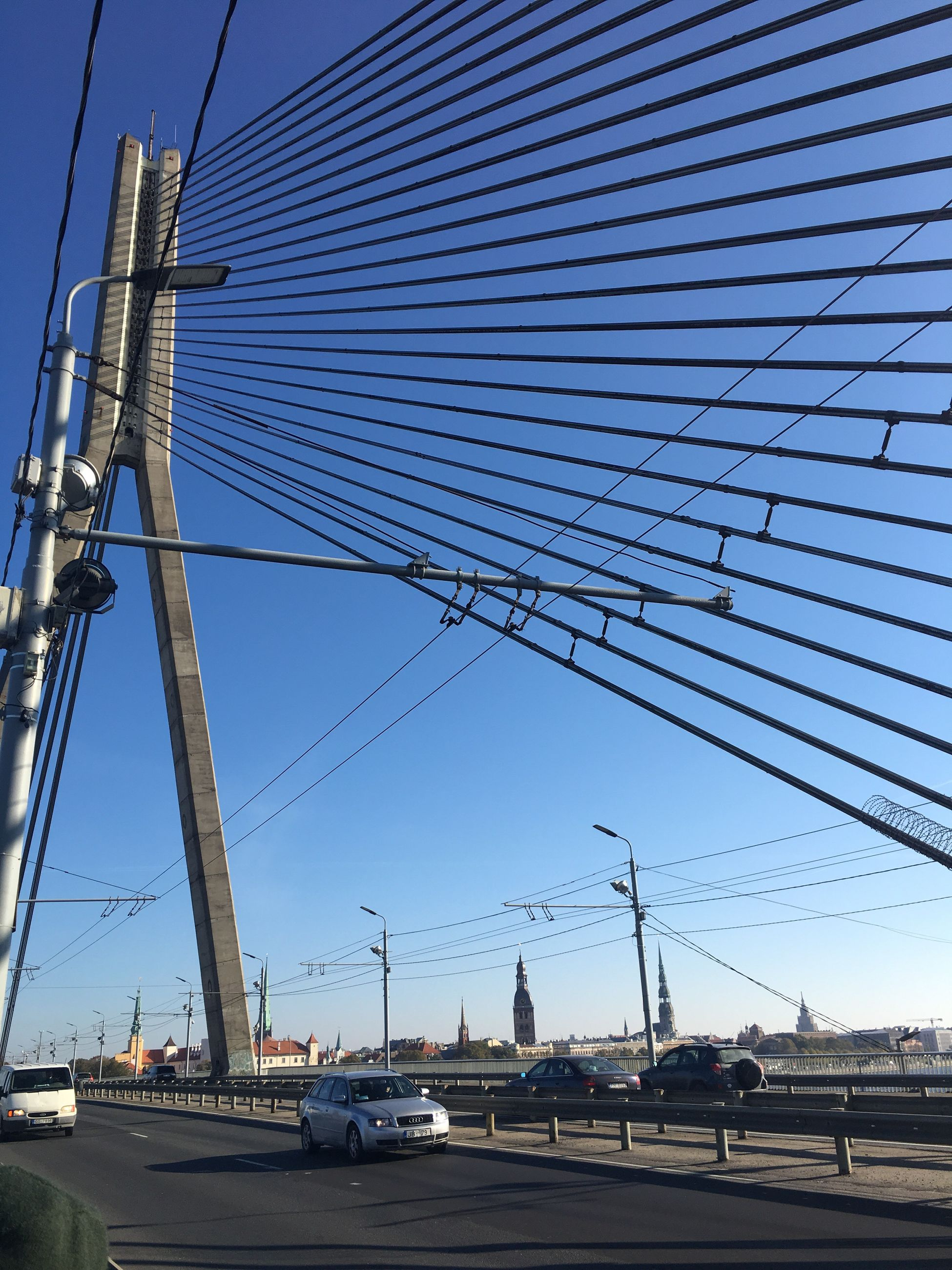 built structure, sky, transportation, architecture, day, no people, outdoors, metal, clear sky, building exterior, city, bridge - man made structure, low angle view, connection, electricity pylon, suspension bridge