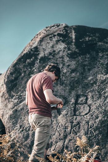 Full length of man on rock