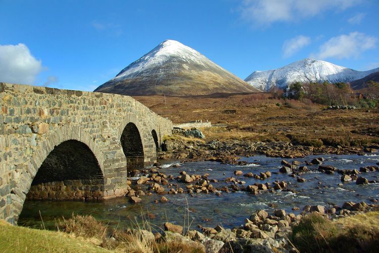 Sligachan Bridge and Glamaig Architecture Beauty In Nature Black Cuillins Bridge Built Structure Climbing Cuillins Day Glamaig Isle Of Skye Mountain Mountaineering Landscape Nature No People Outdoors Red Cuillins River Scenics Sky Sligachan Sligachan Bridge Snowcapped Mountain Tourism Water