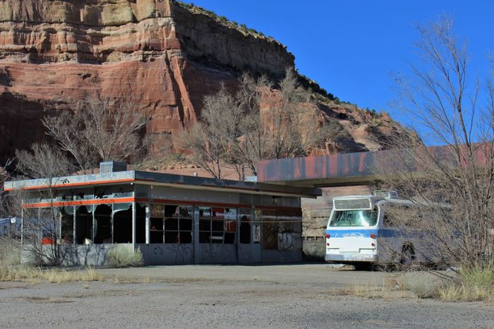 Abandoned gas station with bus at Lupton, Ariz. rest stop. Abandoned Abandoned Buildings Arizona Blue Sky Boarded Up Broken Broken Window Bus Damaged Decrepit Gas Station Graffiti Lupton Old Painted Rock Rest Area Rest Stop Rotting Route 66 Run-down Weathered