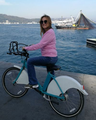 Water Portrait Young Women Full Length Bicycle Looking At Camera Smiling Women Sky Casual Clothing