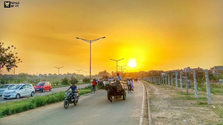 Some moments just make you wanna click them... Multi Colored Cloud - Sky City Life Traffic Travel Transportation Cycling People Riding Travel Destinations Outdoors Sunset Bicycle Motorcycle Sky Rural Scene Adult Animal Themes Day Nature Headwear Beauty In Nature Tree Mammal Only Men
