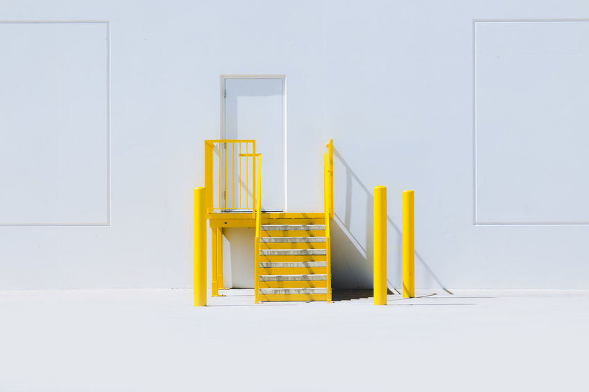 Clear Sky Copy Space Entrance Stairs Absence Architecture Building Built Structure Chair Clean Copy Space Day Door Empty Entrance Indoors  Ladder Minimalism No People Seat Staircase Still Life Wall - Building Feature Warehouse Wood - Material Yellow The Architect - 2018 EyeEm Awards