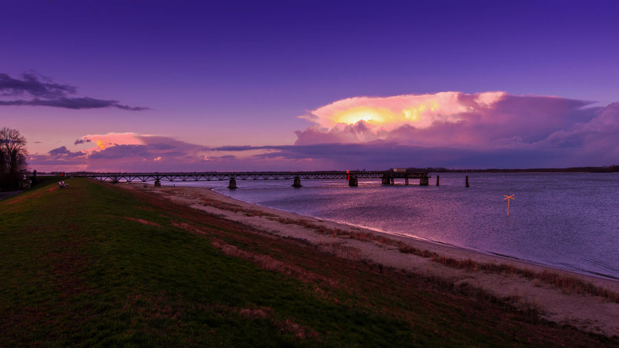 Pier Bad Weather Elbe River Grauer Ort Abbenfleth Sky Water Sunset Sea Cloud - Sky Beauty In Nature Nature Scenics - Nature Tranquil Scene Tranquility Land Beach No People Outdoors Horizon Dusk Architecture Plant Purple