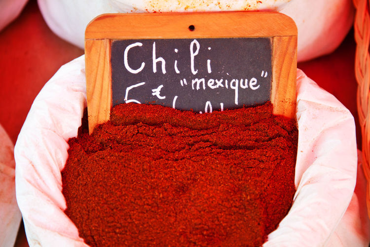 High Angle View Of Chili Powder In Sack At Market For Sale