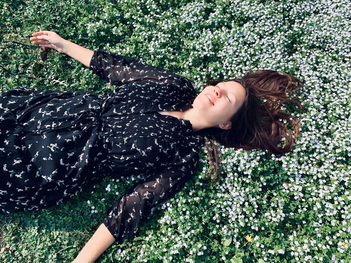 One Person Leisure Activity Lying Down Arms Raised Outdoors Hair Eyes Closed  Relaxation Field Green Color Young Women Young Adult Women Land Nature Lifestyles Real People Springtime Enjoying Life Enjoying The Sun Happiness Relaxing Lying On Back Beautiful Woman Flowerbed Smile Smiling