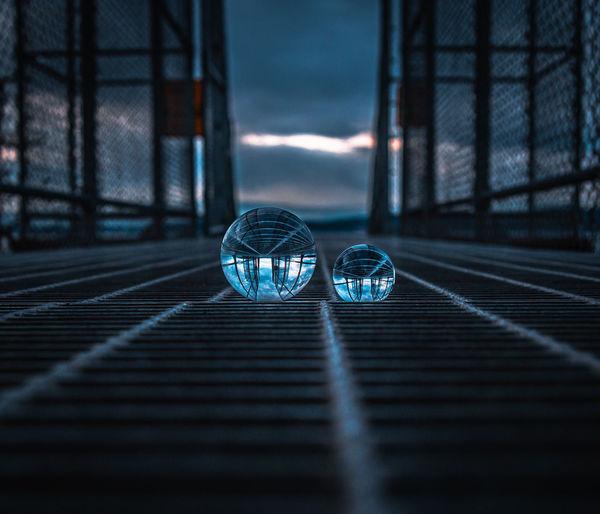 Close-up of crystal ball on footbridge