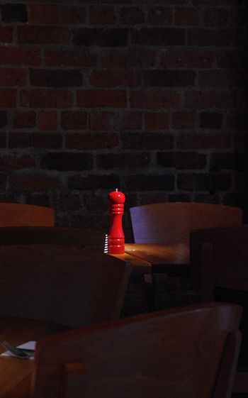 A red pepper grinder, Belfast, Northern Ireland Belfast Brick Wall Bricke Illuminated Kitchen Utensils Kitchenware No People Pepper Pepper Grinder Red Red Tables And Chairs