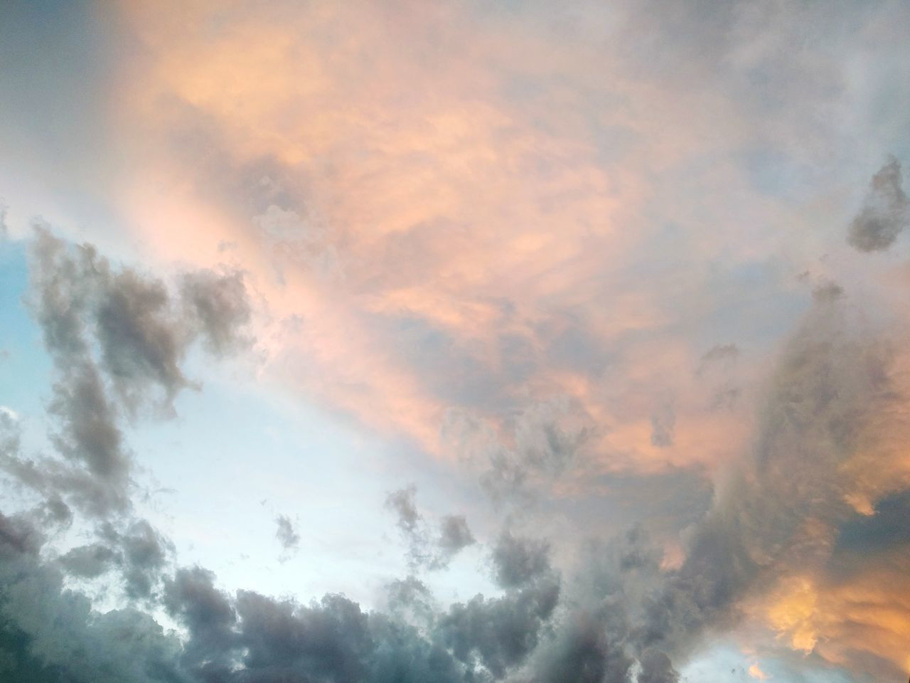 cloud - sky, beauty in nature, sky, nature, dramatic sky, atmospheric mood, scenics, weather, cloudscape, sunset, no people, tranquil scene, backgrounds, sky only, low angle view, tranquility, outdoors, day, multi colored