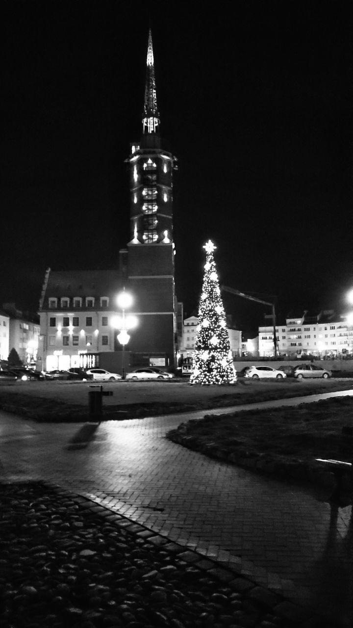 Illuminated Christmas Tree At Church Against Sky