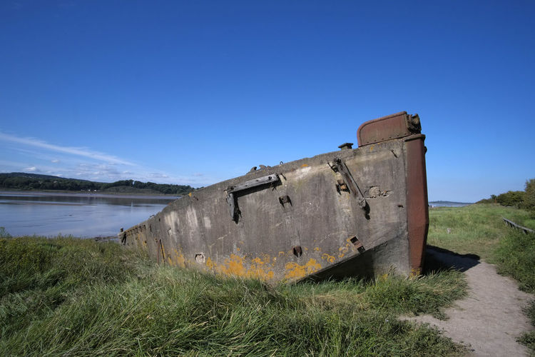 A ferrocement (reinforced concrete barge) FCB 75 built during the second world war and beached as part of the Purton Ship's Graveyard (Purton Hulks) on the bank of the River Severn Estuary at Purton, Gloucestershire, UK. Barge FCB 75 Gloucestersire Purton Hulks Purton Ship's Graveyard Abandoned Boat Concrete Concrete Barge Ferocement Graveyard Hulk Nautical Vessel Outdoors River Severn Ship Sunken