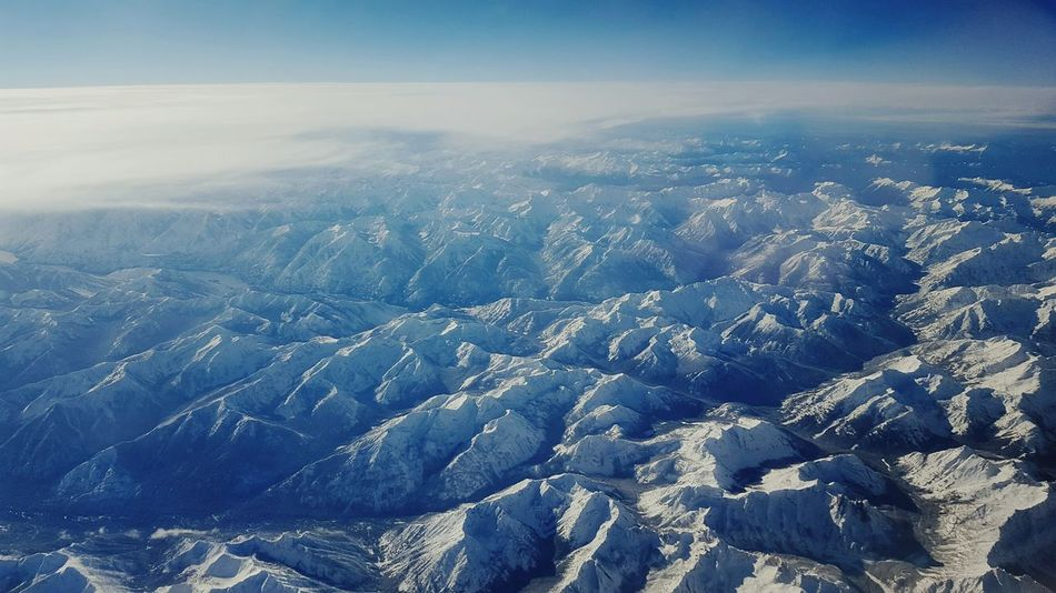 Beauty In Nature Landscape Aerial View No People Sky View From Above View From An Airplane Airplane Airplaneview Mountains Rocky Mountains Breathtaking Nature Scenics Travel Flying Up Above The World So High Travelling Plane Window View Plane Window Plane Mountain Tranquility Snow Snowcapped Mountains Perspectives On Nature