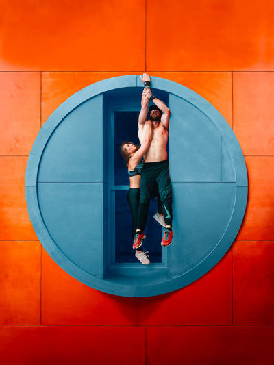 Circular Energy ____________ The big orange circles just asked for a creative approach and pretty soon I had the feeling that a flip here would be very cool, but wanted to approach it just a little bit tried to do this by making use of contrasting colors to the abilities and ideas of these two athletes, you need to pull it off too! Amsterdam Athletics Color Portrait Creativity The Creative - 2018 EyeEm Awards Tree Acrobatics  Athelete athleisure Circle Color Colorful Creative Flip Geometric Shape Ndsm Real People Tones