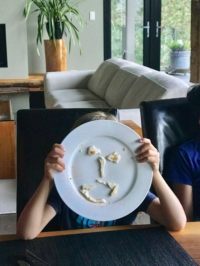 Child having fun playing with his food. Child Child Playing Day Food Food And Drink Freshness Human Hand Indoors  Leisure Activity Lifestyles One Person People Plate Ready-to-eat Real People Refreshment Sitting Sweet Food Table