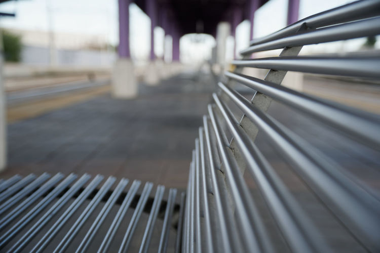 Focus On Foreground Metal Transportation No People Close-up Day Railing In A Row Architecture Outdoors Pattern Rail Transportation Selective Focus Technology Connection Public Transportation Empty Railroad Station City Silver Colored Steel