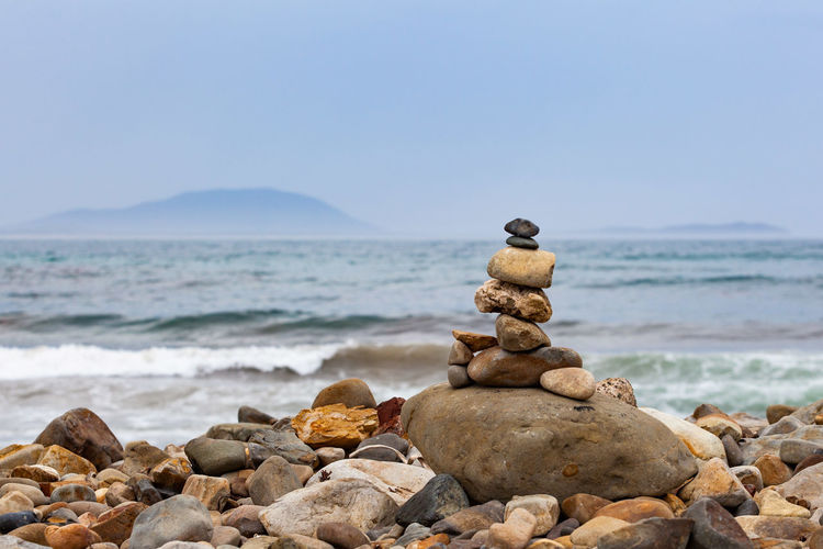 Rock Sea Solid Rock - Object Beach Land Stack Water Balance Beauty In Nature Scenics - Nature Sky Stone - Object Tranquility Stone Tranquil Scene Nature Pebble Zen-like Horizon Over Water No People Outdoors