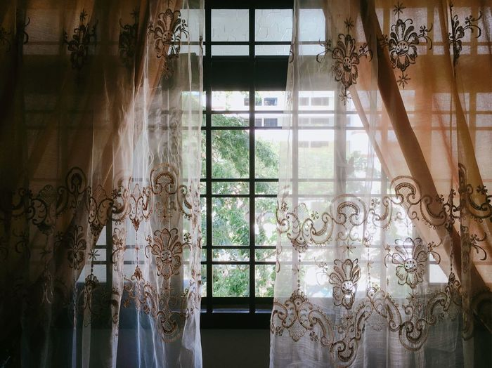 Curtains hanging on window at home