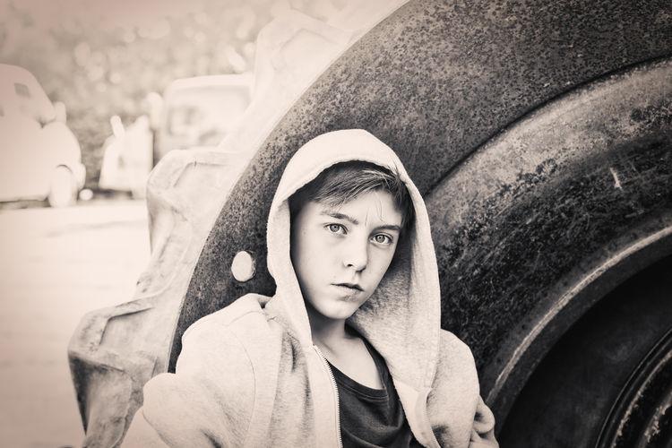 Portrait of teenage girl in car