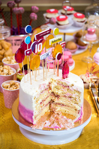Close-up of cake with ice cream on table