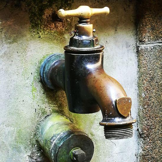 Water Aerosol Can Spraying Faucet Bottle Close-up