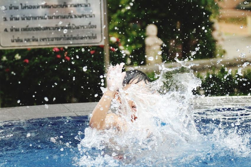 Slomotion Splashing Water Swimming Pool Outdoors City Day Motion One Person People Adults Only Close-up Adult