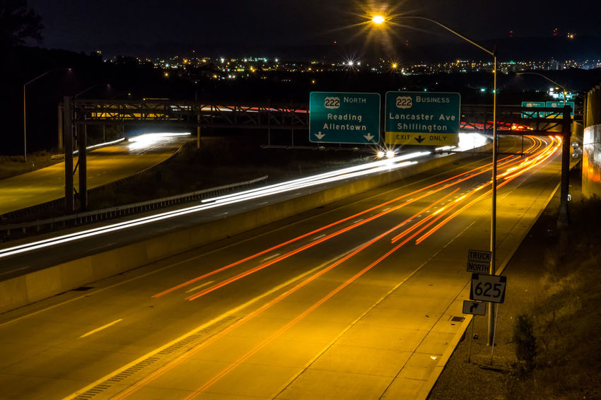 Blurred Motion City Illuminated Light Trail Long Exposure Motion Night No People Outdoors Road Sign Sky Speed Transportation