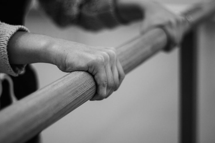 Cropped Hand Of Woman Holding Railing