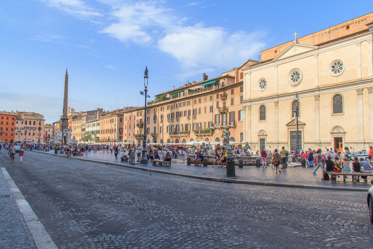 Cobbled Street And Buildings At Piazza Navona Against Sky