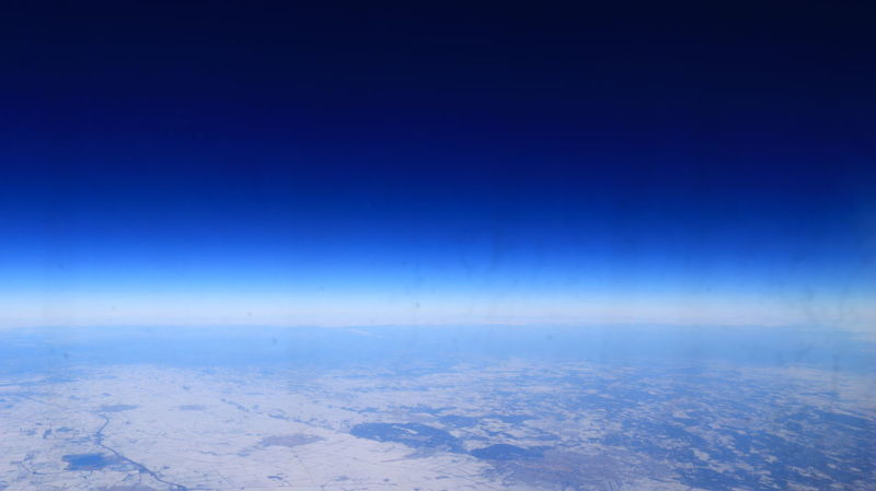 I took this shot from the plane returning to the Netherlands. I can actually ssee where the land ends. Amazing! Gradient Plane View Astronomy Beauty In Nature Blue Bluesky Cold Temperature Gradiented Sky Horizon Line Horizon Over Land Landscape Nature Night No People Outdoors Scenics Sky Skyview Snow Tranquil Scene Tranquility Winter Shades Of Winter