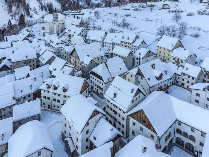 High angle view of buildings seen through snow covered land