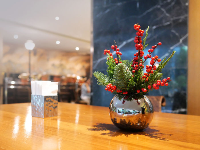 Table Indoors  Plant Glass - Material Vase Transparent Flowering Plant No People Decoration Nature Flower Potted Plant Wood - Material Focus On Foreground Growth Illuminated Home Interior Business Close-up Freshness Flower Arrangement Flower Pot Houseplant Bouquet Xmas Time
