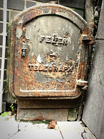 Old German Fire Telegraph Rotten Ancient Firefighter Old Buildings Vintage Telegraph Text Day Communication Weathered No People Outdoors Rusty Close-up