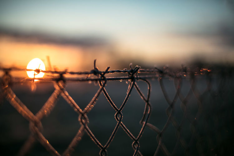 Barbed Wire Canonphotography Chainlink Fence Close-up Danger Day Discover Your City Focus On Foreground Light And Shadow Metal Nature No People Outdoors Protection Razor Wire Safety Sea Security Sky Sunset The Week Of Eyeem Travel Water