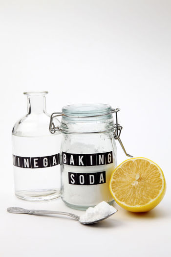 baking soda in the glass container wwith vinegar Alkaline Anti Inflammatory Baking Soda Bicarbonate Clear Sky Close-up Cooking Glass Container Heart Burn Ingredient Jar Label Lemon Medicine Neutralizer Sodium Bicarbonate Spoon Spoonful Vinegar White Background White Vinegar