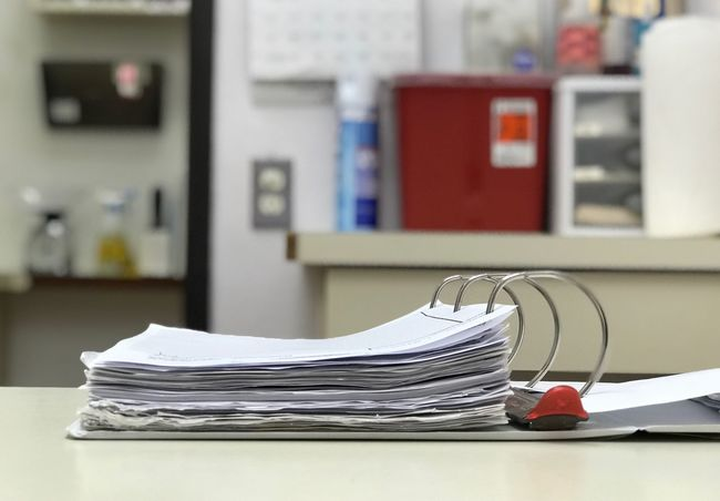 Veterinarian Animal Vet Office Office Hospital Paper Stack Document Table Indoors  No People Focus On Foreground Still Life Publication Education Paperwork Close-up Book Business Selective Focus