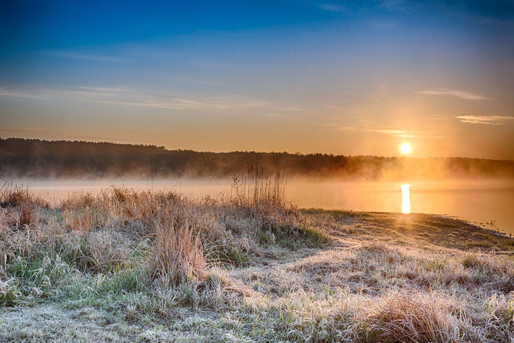 Magical sunrise with light fog over a lake (Zalew Chancza, Poland) Beauty In Nature Day Fog Frost Grass Landscape Misty Nature No People Outdoors Scenics Sky Sunset Tranquil Scene Tranquility Water